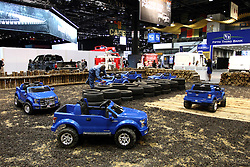 12 February 2015:  To keep the youngsters entertained, Ford miniature trucks to drive on their own off road course.<br /> <br /> First staged in 1901, the Chicago Auto Show is the largest auto show in North America and has been held more times than any other auto exposition on the continent. The 2015 show marks the 107th edition of the Chicago Auto Show. It has been  presented by the Chicago Automobile Trade Association (CATA) since 1935.  It is held at McCormick Place, Chicago Illinois