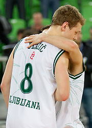 Jaka Blazic of Union Olimpija and Jan Mocnik of Union Olimpija after the basketball match between KK Union Olimpija and Unics Kazan (RUS) of 10th Round in Group D of Regular season of Euroleague 2011/2012 on December 21, 2011, in Arena Stozice, Ljubljana, Slovenia. Unics Kazan defeated Union Olimpija 76-63. (Photo by Vid Ponikvar / Sportida)
