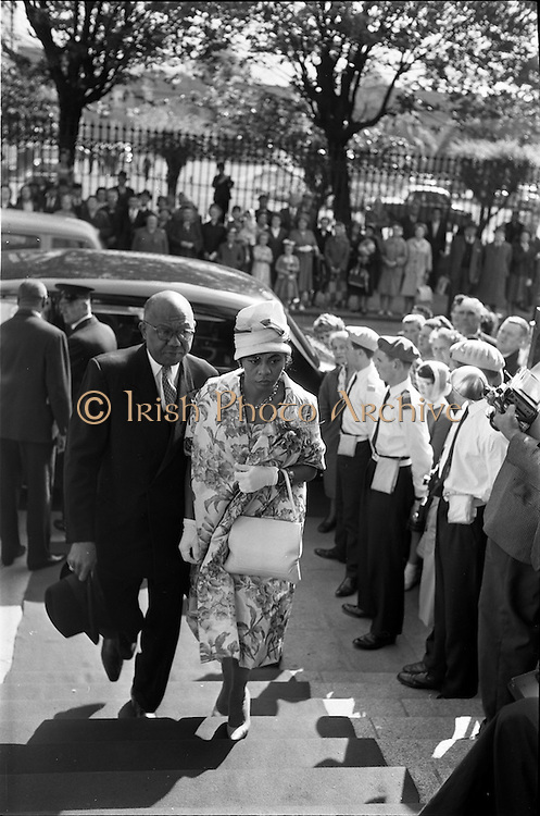 25/07/1962<br /> 07/25/1962<br /> 25 July 1962<br /> Consecration Rev. Dr Grimley S.M.A. as Bishop of Cape Palmas, Liberia at the Pro Cathedral, Dublin. Picture shows Mr George Brewer, Liberian Ambassador to United Kingdom and Northern Ireland and Mrs Brewer arriving at the Pro Cathedral, Dublin for the ceremony.