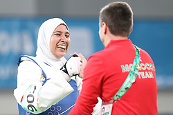 BUENOS AIRES, Oct. 12, 2018  Fatima-Ezzahra Aboufaras (L) of Morocco celebrates with coach after the women's +63kg taekwondo final against Kimia Hemati of Iran at the 2018 Summer Youth Olympic Games in Buenos Aires, Argentina on Oct. 11, 2018. Fatima-Ezzahra Aboufaras won 18-16. (Credit Image: © Li Ming/Xinhua via ZUMA Wire)