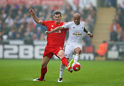 SWANSEA, WALES - Sunday, May 1, 2016: Liverpool's Dejan Lovren in action against Swansea City's Andre Ayew during the Premier League match at the Liberty Stadium. (Pic by David Rawcliffe/Propaganda)