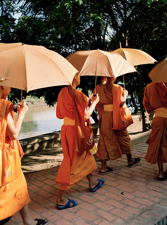 Monks and umbrellas.