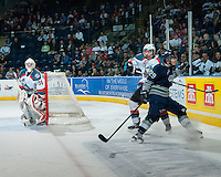 KELOWNA, CANADA - APRIL 3: Roberts Lipsbergs #29 of the Seattle Thunderbirds checks Colten Martin #8 of the Kelowna Rockets on April 3, 2014 during Game 1 of the second round of WHL Playoffs at Prospera Place in Kelowna, British Columbia, Canada.   (Photo by Marissa Baecker/Getty Images)  *** Local Caption *** Roberts Lipsbergs; Colten Martin;