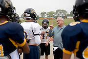 Defensive coordinator Mike Copeland goes over defensive schemes at Stephenville High School in Stephenville, Texas on November 5, 2013. (Cooper Neill / for The New York Times)