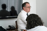 Rawan (foreground) listens as her lawyer Michael Vidler, talks while sitting in a room in Hong Kong on February 25th, 2019. Reem, aged 20, and Rawan (aged 18) (not their real names) fled from their abusive family and Saudi Arabia's oppressive conditions while on holiday in Sri Lanka and were intercepted in Hong Kong on their way to Australia to seek asylum. <br /> Photo by Suzanne Lee/PANOS for TIME