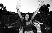 A happy woman in the middle of a festival crowd, Australia 2000's
