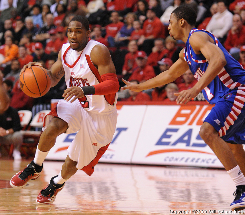 Jan 31, 2009; Piscataway, NJ, USA; Rutgers guard Anthony Farmer (2) drives towards the basket against DePaul guard Jeremiah Kelly (11) during the first half of Rutgers' 75-56 victory over DePaul in NCAA college basketball at the Louis Brown Athletic Center