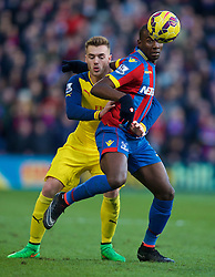 LONDON, ENGLAND - Saturday, February 21, 2015: Arsenal's Calum Chambers and Crystal Palace's Yannick Bolasie during the Premier League match at Selhurst Park. (Pic by David Rawcliffe/Propaganda)