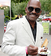 Rodney Tims of Miami, Florida samples the fare from Fleming's Prime Steakhouse during the 21st annual The Taste in the Lincoln Park Commons area at the Fraze Pavilion, Thursday, September 3, 2009.