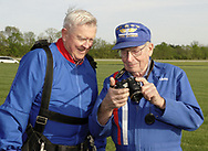 John Lane, from Lebanon (right) shows David Morgan, from Monroe the pictures he took of David's landing at Start Skydiving's sky diving festival at the Warren County Airport, Sunday afternoon.