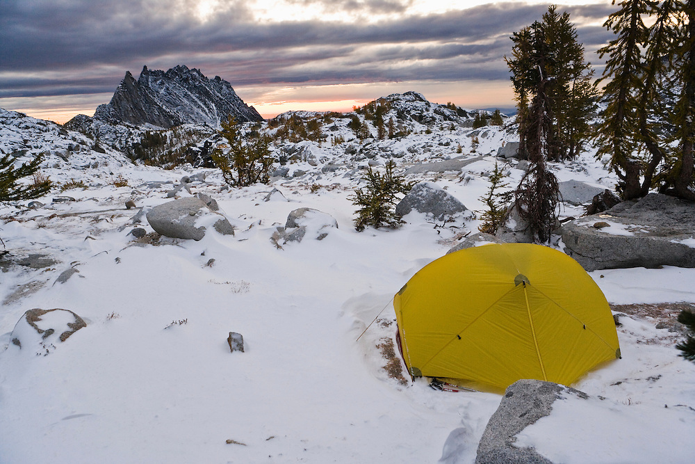 A tent in the upper Enchantments with Prusik Peak in the distance, Enchantment Lakes Wilderness Area, Washington Cascades, USA.
