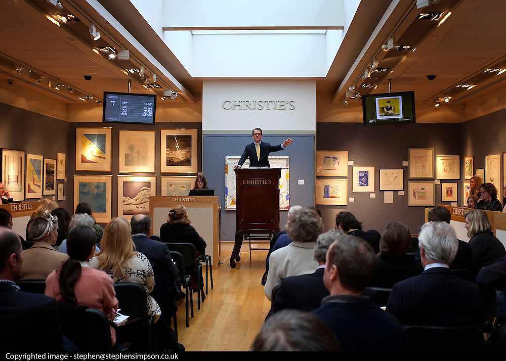 © Licensed to London News Pictures. 17/02/2012, London, UK. The auctioneer takes bids from the floor. An auction of items by British artist David Hockney takes place at Christie's in London's South Kensington today, 17th February 2012. It features over 100 works by Hockney, including etchings, lithographs, drawings and photography. They are expected to sell for over £1m. The sale spans over 40 years of Hockney's career. Photo credit : Stephen Simpson/LNP