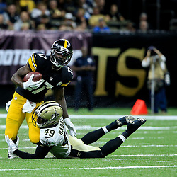 Aug 26, 2016; New Orleans, LA, USA;  New Orleans Saints cornerback De'Vante Harris (49) tackles Pittsburgh Steelers wide receiver Eli Rogers (17) during the first half of a preseason game at Mercedes-Benz Superdome. Mandatory Credit: Derick E. Hingle-USA TODAY Sports