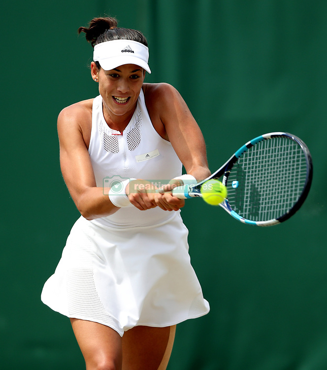 Garbine Muguruza in action against Angelique Kerber on day seven of the Wimbledon Championships at The All England Lawn Tennis and Croquet Club, Wimbledon.
