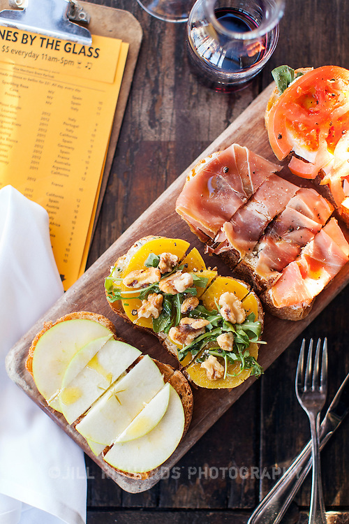 Postino East's insanely popular special on Monday and Tuesday—$20 for any bottle of wine and a bruschetta board. Postino East, nestled in the shadow of the iconic Gilbert water tower, offers diners an indoor and outdoor bar.
