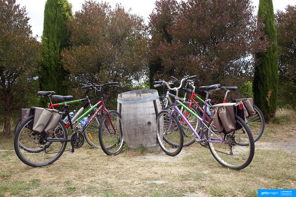 Bikes parked in a wine barrel bicycle rack at  Highfield Estate WInery,  Brookby Road, Blenheim, Marlborough as tourists visit the vineyards of the Marlborough Wine Region, with Wine Tours by Bike. Marlborough has over 40 wineries within a 10km radius of Blenheim. Marlborough, South Island, New Zealand...The Marlborough wine region is New Zealand's largest wine producer. The Marlborough wine region has earned a global reputation for viticultural excellence since the 1970s. It has an enviable international reputation for producing the best Sauvignon Blanc in the world. It also makes very good Chardonnay and Riesling and is fast developing a reputation for high quality Pinot Noir. Of the region's ten thousand hectares of grapes (almost half the national crop) one third are planted in Sauvignon Blanc. Marlborough, New Zealand, 13th February 2011. Photo Tim Clayton