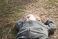 Boy taking a nap on grass high angle view