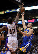 Apr 5, 2013; Phoenix, AZ, USA; Golden State Warriors guard Stephen Curry (30) lays up the ball against the Phoenix Suns forward P.J. Tucker (17) in the first half at US Airways Center. Mandatory Credit: Jennifer Stewart-USA TODAY Sports