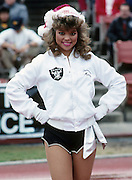 A Los Angeles Raiders cheerleader performs during the NFL football game between the Seattle Seahawks and the Oakland Raiders on December 18, 1988 in Los Angeles, California. The Seahawks won the game 43-37. ©Paul Anthony Spinelli