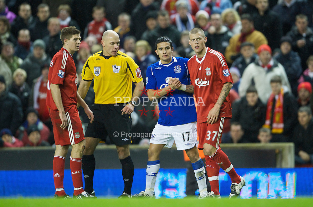 LIVERPOOL, ENGLAND - Monday, January 19, 2009: Liverpool's Martin Skrtel and Everton's Tim Cahill during the Premiership match at Anfield. (Photo by David Rawcliffe/Propaganda)