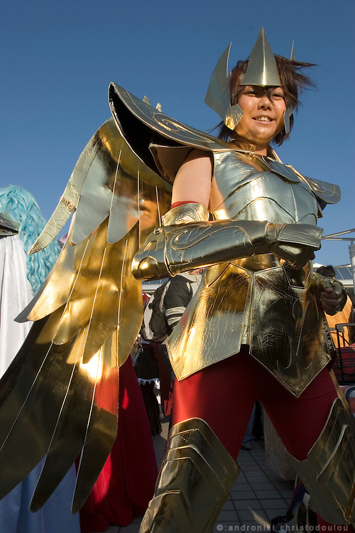 """Cosplayer dressed as """"Sagitarius"""", character from the action game """"SAINT SEIYA"""".  TOKYO COMIC MARKET """"COMIKET"""" the biggest comic market in Japan. Independent designers come to sell their comics, there is anime, manga, cosplay, toys, posters etc. At """"Tokyo Big Sight"""" exhibition center."""