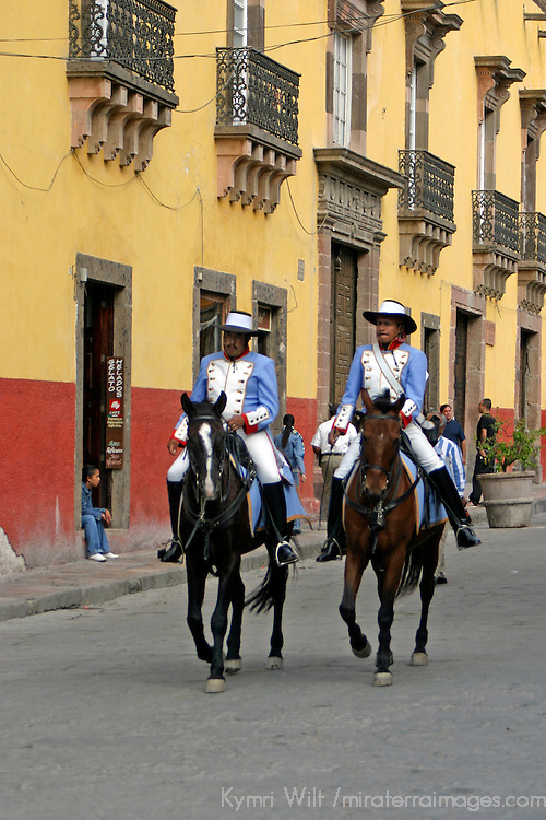 North America, Mexico, San Miguel de Allende.  Horseback caballeros ride through the center of town in San Miguel de Allende.
