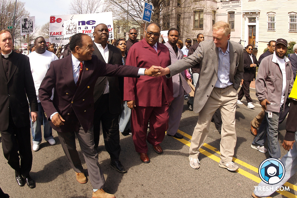 Rev. Walter Fauntroy, left, greets Washington D.C. Councilman Jack Evans at the Shaw neighborhood anti-violence march and rally Saturday, March 31, 2007. Directly bbehind their handshake in maroon is Bishop C.L. Long,