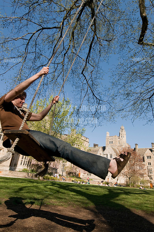 Students having Fun with a Tree Swing. Yale University Campus, in the Branford College Quad in April
