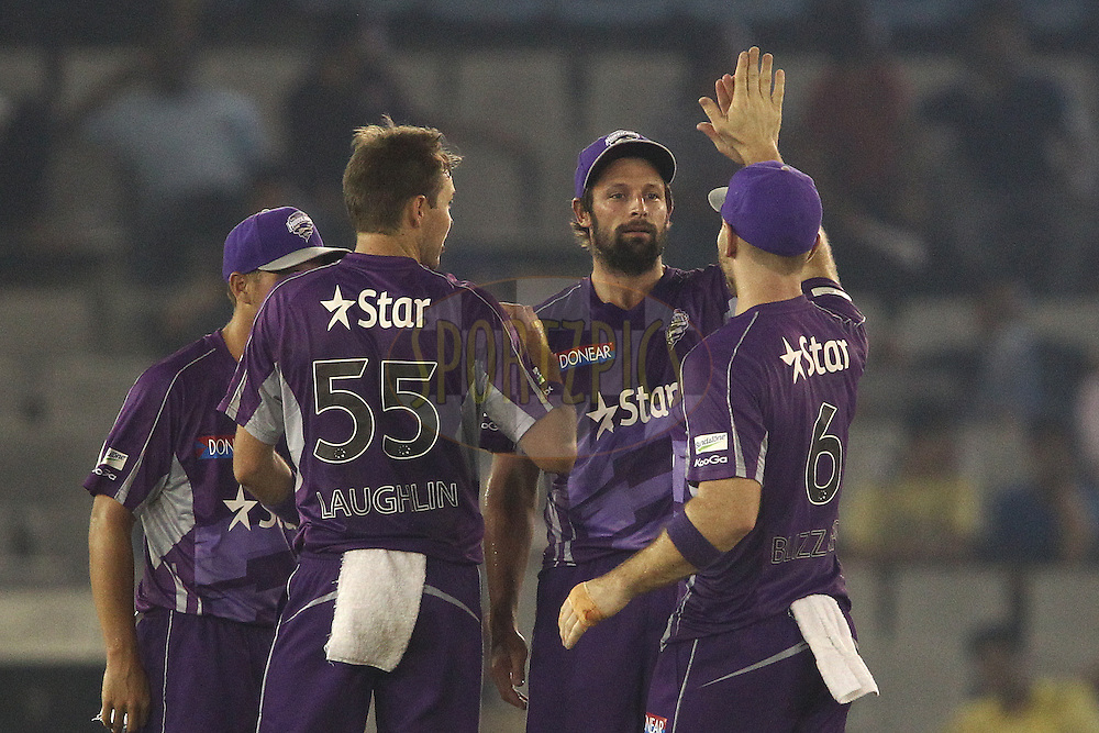 Ben Hilfenhaus of the Hobart Hurricanes is congratulated by Aiden Blizzard of the Hobart Hurricanes for taking the catch to get Manan Vohra of the Kings XI Punjab wicket during match 2 of the Oppo Champions League Twenty20 between the Kings XI Punjab and the Hobart Hurricanes held at the Punjab Cricket Association Stadium, Mohali, India on the 18th September 2014<br /> <br /> Photo by:  Shaun Roy / Sportzpics/ CLT20<br /> <br /> <br /> Image use is subject to the terms and conditions as laid out by the BCCI/ CLT20.  The terms and conditions can be downloaded here:<br /> <br /> http://sportzpics.photoshelter.com/gallery/CLT20-Image-Terms-and-Conditions-2014/G0000IfNJn535VPU/C0000QhhKadWcjYs