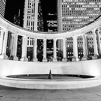 Chicago Millennium Monument black and white picture.  Millennium Monument is a peristyle and fountain located in Wrlgley Square which is part of Millennium Park and Grant Park. The monument lists The Founders of Millennium Park