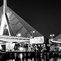Boston panorama black and white photo of the Zakim Bunker Hill Bridge at night. The Leonard P. Zakim Bunker Hill Memorial Bridge is a cable bridge that spans the Charles River in Boston, Massachusetts in the Eastern United States of America. Copyright ⓒ Paul Velgos with All Rights Reserved.