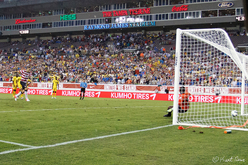 USA Men's National Team forward CLINT DEMPSEY (8) scores a goal from a penalty kick during the Antigua & Barbuda vs USA Men's National Team  semifinal round of 2014 FIFA World Cup qualifier at Raymond James Stadium in Tampa, Fl. .