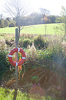lifebuoy beside a small river in Cabinteely Park Dublin