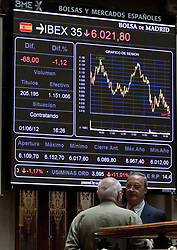 April 25, 2013. File Photo - A Traders in Front of to Electronic Stick Board AT The Bolsa de Madrid in Madrid Capital of Spain June 1 2012 Madrid S IBEX 35 Index fell on Friday to 6 065 Points following successive decline in The Whole Week. June 2, 2012. Photo By imago/i-Images<br />
