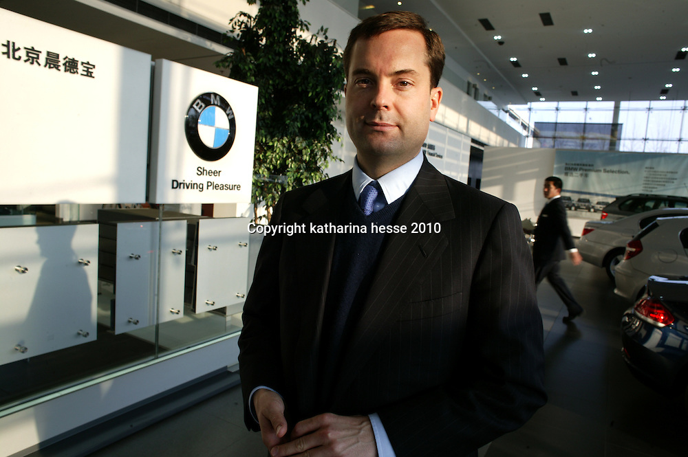 BEIJING, APRIL-22, 2010: Mark McLarty, a son of Bill Clinton's chief of staff Mack McLarty, who runs a dozen stores in China, stands inside the BMW showroom.