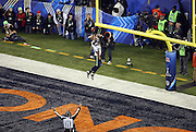 Seattle Seahawks outside linebacker Malcolm Smith (53) leaps and dunks the ball over the goal post as he intercepts a pass intended for Denver Broncos running back Knowshon Moreno (27) and runs it back for a pick six touchdown that gives the Seahawks a 22-0 lead in the second quarter during the NFL Super Bowl XLVIII football game against the Denver Broncos on Sunday, Feb. 2, 2014 in East Rutherford, N.J. The Seahawks won the game 43-8. ©Paul Anthony Spinelli