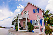 Pink cottage along the harbor in the tiny village of Hope Town, Elbow Cay Abacos, Bahamas.