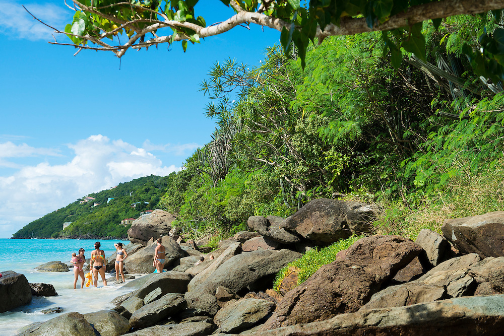 Four women and their young children enjoy a beautiful day at the beach on Magens Bay in St. Thomas, USVI
