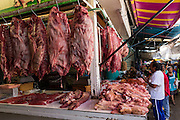Fresh slaughtered pork at Benito Juarez market in Oaxaca, Mexico.