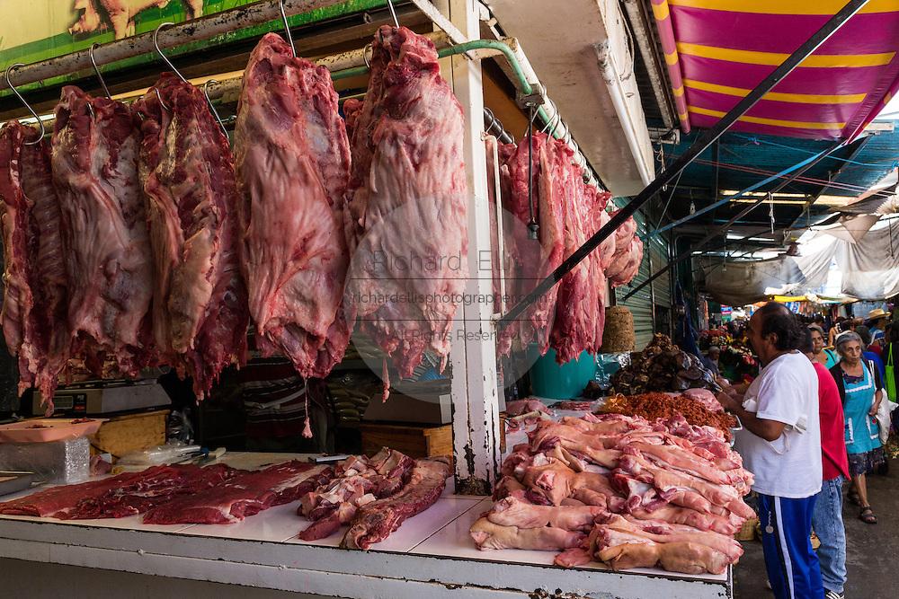 Fresh slaughtered pork at Benito Juarez market in Oaxaca, Mexico.