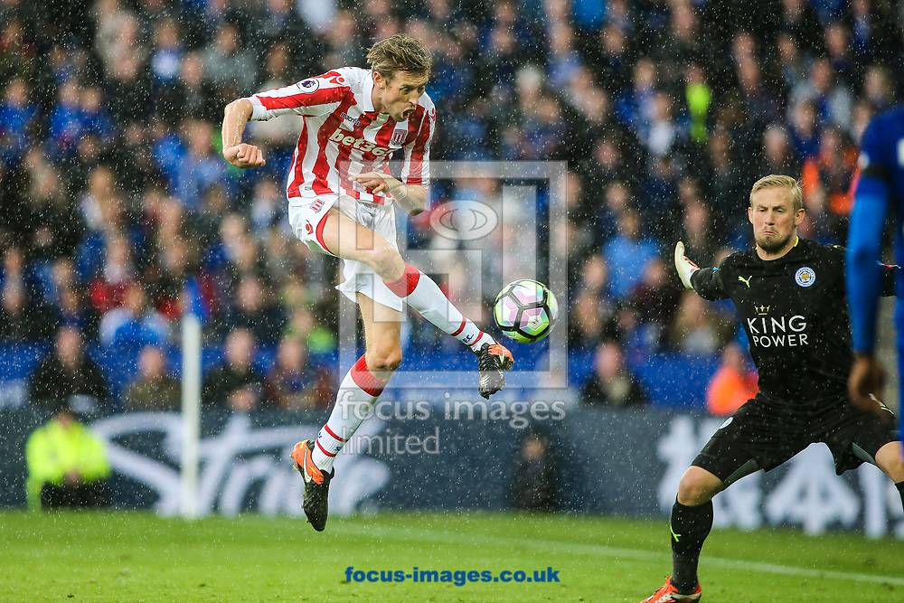 Peter Crouch of Stoke City (left) shoots at goal during the Premier League match at the King Power Stadium, Leicester<br /> Picture by Andy Kearns/Focus Images Ltd 0781 864 4264<br /> 01/04/2017