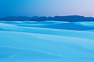 Dusk light falls across the vast desert landscape of White Sands National Monument, New Mexico