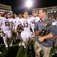 Thomas Wells | Buy at PHOTOS.DJOURNAL.COM<br /> East Webster head coach Doug Wilson carries the second place trophy following their 39-20 defeat to Basfield in the 2A State Championship game on Friday in Oxford.
