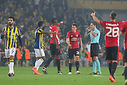 Paul Pogba Midfielder of Manchester United and Ander Herrera Midfielder of Manchester United argue with referee Milorad Mazic during the Europa League match between Fenerbahce and Manchester United at the Ulker Stadium, Kadikoy, Turkey on 3 November 2016. Photo by Phil Duncan.