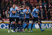 Tottenham Hotspur forward Harry Kane (10) scores a goal and celebrates to make the score 0-1 during the Barclays Premier League match between Stoke City and Tottenham Hotspur at the Britannia Stadium, Stoke-on-Trent, England on 18 April 2016. Photo by Simon Davies.