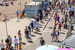© Licensed to London News Pictures. 31/05/2020. Brighton, UK. Long queues form for the public toilets on the Brighton and Hove seafront as thousands of visitors take to the seaside resort. Photo credit: Hugo Michiels/LNP