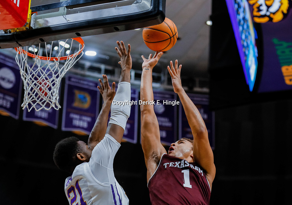 Jan 23, 2018; Baton Rouge, LA, USA; Texas A&M Aggies forward DJ Hogg (1) shoots over LSU Tigers forward Aaron Epps (21) during the first half at the Pete Maravich Assembly Center. Mandatory Credit: Derick E. Hingle-USA TODAY Sports