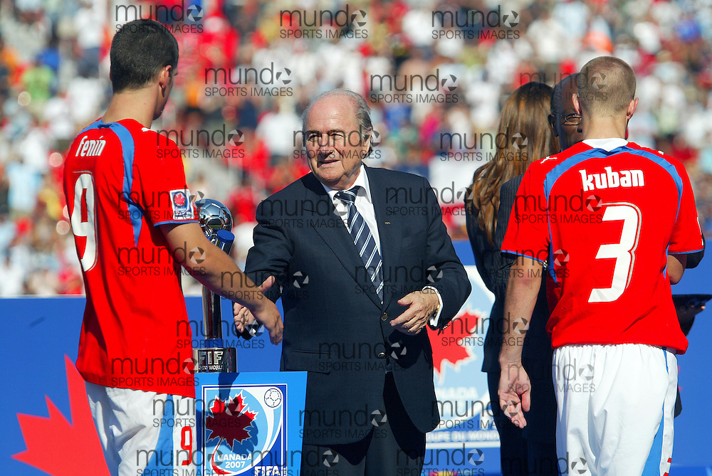 FIFA President Joseph S. Blatter(C) congratulates the Czech Republic's Martin Fenin following his teams loss to Argentina in the final at the FIFA U-20 World Cup on 22 July 2007 in Toronto, Ontario, Canada. .AFP PHOTO/GEOFF ROBINS