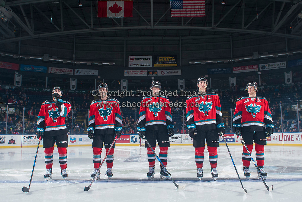 KELOWNA, CANADA - OCTOBER 27: Kyle Topping #24, Kole Lind #16, Nolan Foote #29, Cal Foote #25 and Gordie Ballhorn #4 of the Kelowna Rockets stand on the blue line against the Tri-City Americans on October 27, 2017 at Prospera Place in Kelowna, British Columbia, Canada.  (Photo by Marissa Baecker/Shoot the Breeze)  *** Local Caption ***
