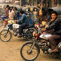 Samlor driver waits for customers at market, Luang Phrabang, Laos